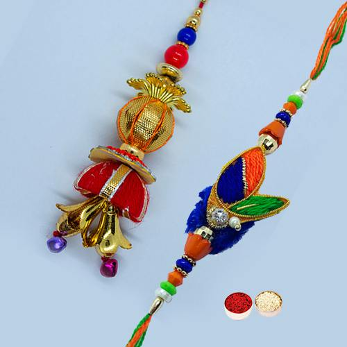Enticing Gift of Couple Rakhi Set for Bhaiya N Bhabhi with free Roli Tilak, and Chawal on the Occasion of Raksha Bandhan