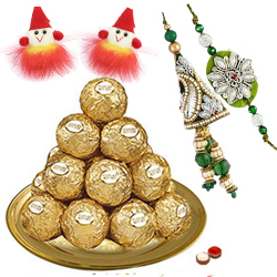 Daintily Arranged Ferrero Rocher Chocolates in a Golden Plated Thali with Family Set of Rakhi and Roli Tilak Chawal