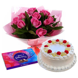 Beautiful Pink Rose Arrangement with Cake and Cadbury Celebration