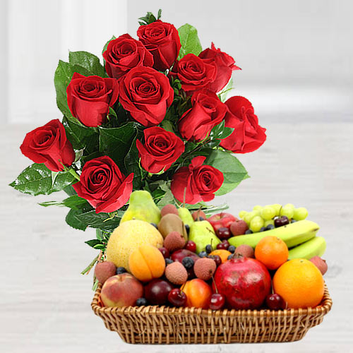 Splendid 12 Red Roses along with healthy 2 Kg. Fruit basket