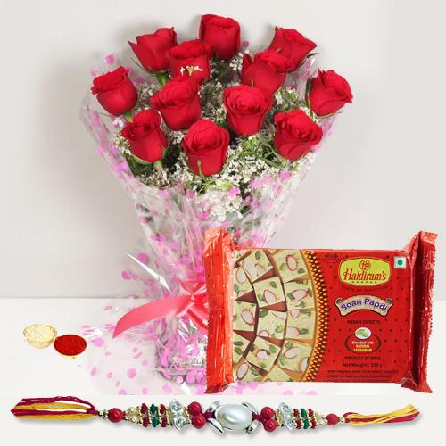 Delicious Soan Papri and Attractive Red Roses Bunch with Rakhi Roli Tika and Chawal for your Loving Brother