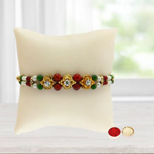 Beautiful Pious Rakhi with Free Roli Tilak and Chawal for your Precious Brother on the Occasion of Rakhi