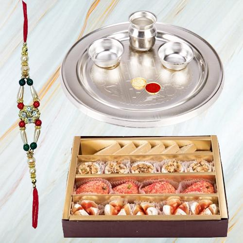 Delicious Assorted Sweets Gift Pack with Rakhi N Silver Plated Paan Shaped Puja Aarti Thali along with Roli Tilak N Chawal for your Sweet Brother