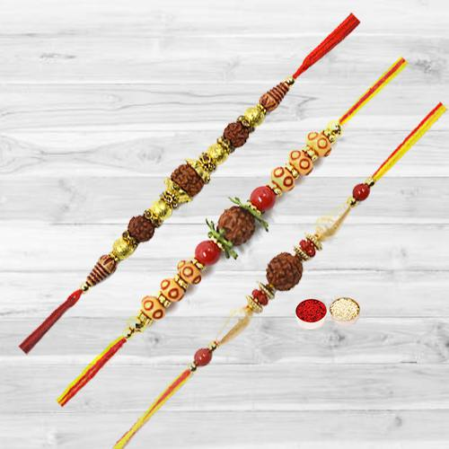 Remarkable Rakhi Special Gift of Three Rudraksha Rakhi with free Roli Tika and Chawal