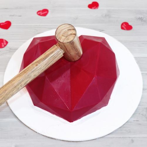Delicious Red Heart Shape Piñata Cake with Hammer
