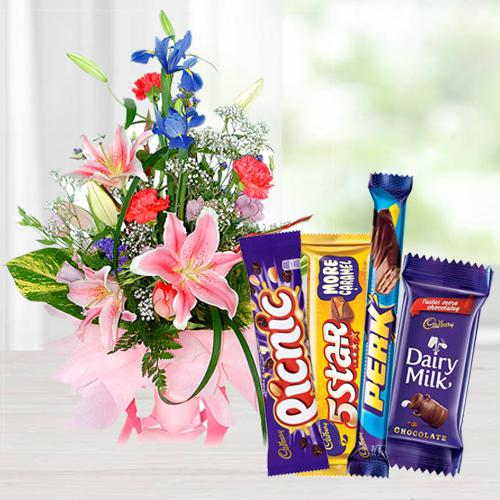 Unique seasonal Flowers including yummy assorted Cadburys Chocolate
