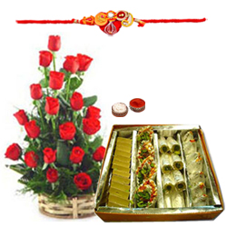Classic Arrangement of Roses in a Basket and Assorted Sweets Gift Pack with Free Rakhi, Roli Tika and Chawal for Rakhi Celebration