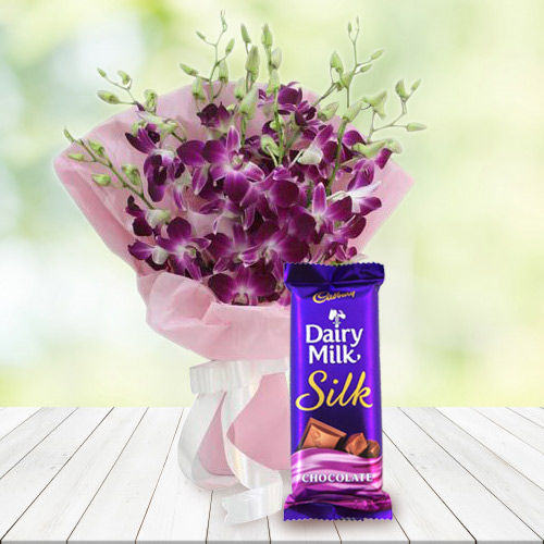Cute Bouquet of Orchids and Dairy Milk Silk
