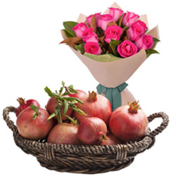 Healthy Treat of Pomegranates Basket with Pink Roses Bouquet