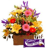 Magnificent Flower arrangement an assortment and yummy Cadburys Chocolate