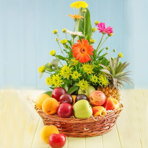 Plentiful Fresh Fruits with Gerberas Gift Basket