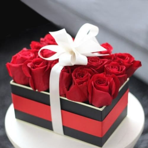 Mesmerizing Red Roses Box Tied with White Ribbon