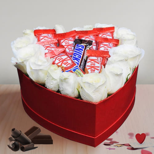 Breathtaking Display of White Roses N Chocolate in Heart Box