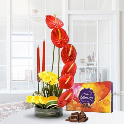 Stylish Flower Arrangement with Candles n Cadbury Celebration