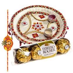 Relishing  Ferreo Rocher Chocolates and a special Pooja Thali with a Free Rakhi, Roli Tilak and Chawal